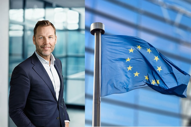 telias vd Johan Dennelind och EU:s flagga